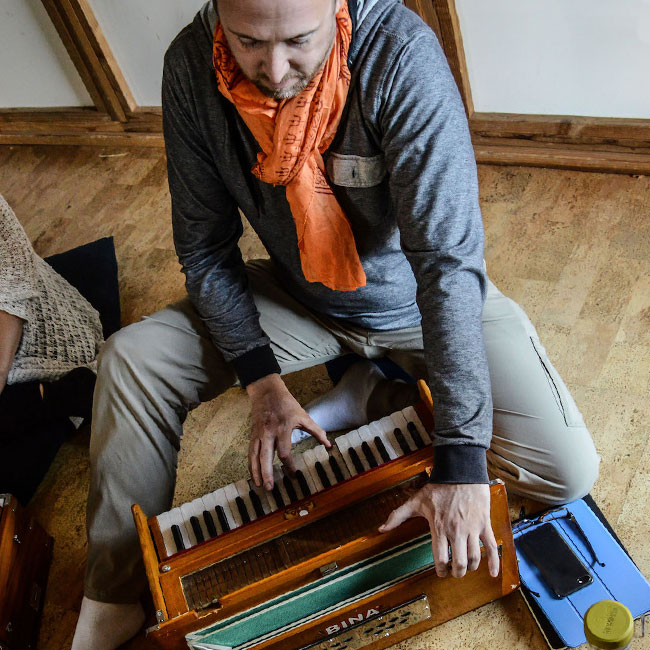 Kirtan Student Playing Harmonium